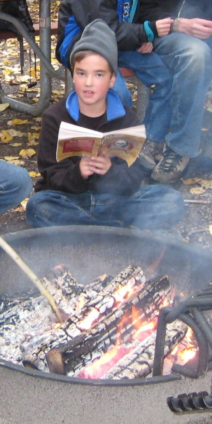 luke-reading-by-the-camp-fire-8-years-old